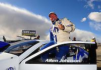 Apr. 1, 2012; Las Vegas, NV, USA: NHRA pro stock driver Allen Johnson celebrates after winning the Summitracing.com Nationals at The Strip in Las Vegas. Mandatory Credit: Mark J. Rebilas-