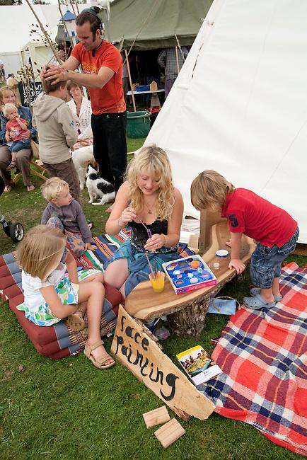 Children gravitate to the face painter at the Sturminster Newton Cheese Festival. Dorset