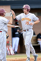 First baseman Mark Lowrie (15) of the Winthrop University Eagles is congratulated after scoring a run in a game against the University of South Carolina Upstate Spartans on Wednesday, March 4, 2015, at Cleveland S. Harley Park in Spartanburg, South Carolina. Upstate won, 12-3. (Tom Priddy/Four Seam Images)