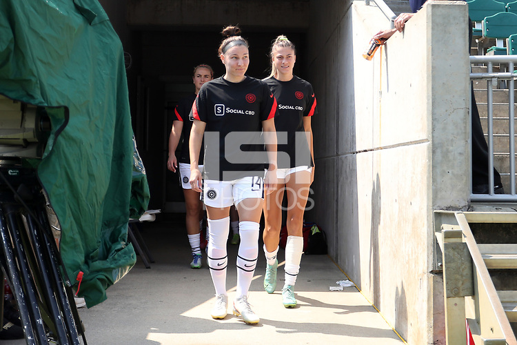CARY, NC - SEPTEMBER 12: Natalia Kuikka #14 and Kelli Hubly #20 of the Portland Thorns FC take the field before a game between Portland Thorns FC and North Carolina Courage at Sahlen's Stadium at WakeMed Soccer Park on September 12, 2021 in Cary, North Carolina.