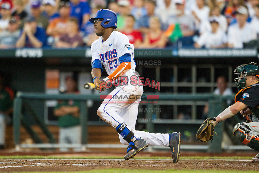 Florida Gators outfielder Buddy Reed (23) follows through on his swing against the Miami Hurricanes in the NCAA College World Series on June 13, 2015 at TD Ameritrade Park in Omaha, Nebraska. Florida defeated Miami 15-3. (Andrew Woolley/Four Seam Images)