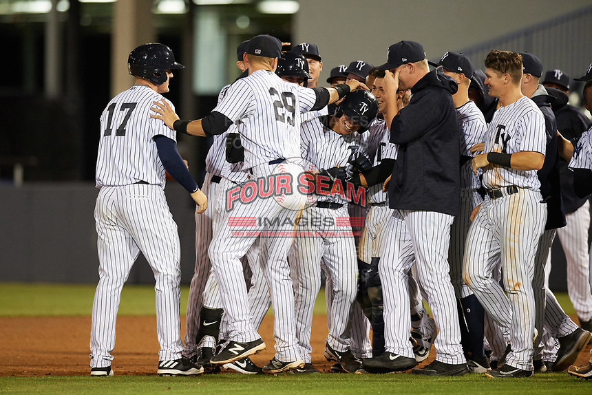 Tampa Yankees second baseman Nick Solak (39) is mobbed by teammates, including Trey Amburgey (17), Matt Snyder (29), and Sharif Othman (62), after a walk off base hit during a game against the Fort Myers Miracle on April 12, 2017 at George M. Steinbrenner Field in Tampa, Florida.  Tampa defeated Fort Myers 3-2.  (Mike Janes/Four Seam Images)