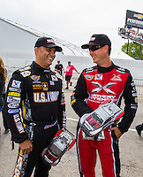 Aug 30, 2014; Clermont, IN, USA; NHRA top fuel dragster driver Tony Schumacher (left) and Spencer Massey at driver introductions for the Traxxas Shootout during qualifying for the US Nationals at Lucas Oil Raceway. Mandatory Credit: Mark J. Rebilas-USA TODAY Sports