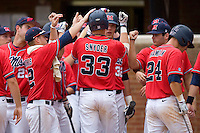 Matt Snyder #33 of the Ole Miss Rebels is congratulated by his teammates after hitting a grand slam in the 9th inning against the St. John's Red Storm at the Charlottesville Regional of the 2010 College World Series at Davenport Field on June 6, 2010, in Charlottesville, Virginia.  The Red Storm defeated the Rebels 20-16.  Photo by Brian Westerholt / Four Seam Images