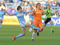 # 8 Megan Rapinoe of the Chicago Red Stars pass the ball upfield against  # 3 Christie Rampone  Sky Blue FC fight for control of the ball.  Sky Blue FC beat the Red Star 2-0.