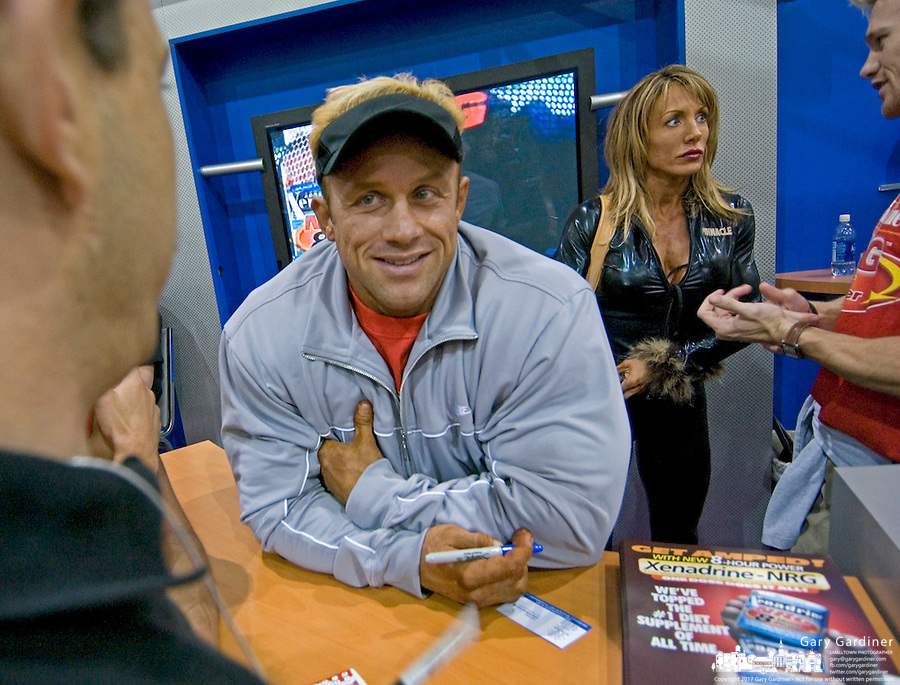 Bodybuilder Craig Titus, left center, talks with a fan during the Arnold Fitness EXPO at the 2004 Arnold Classic bodybuilding competition in Columbus, Ohio, in this March 7, 2004, file photo. At right rear is his wife and fitness competitor Kelly Ryan. Titus and his wife have been charged in the murder and burning of the body of their roommate in Las Vegas.