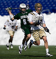 Josh Hawkins (5) of Loyola comes up behind Mary Gallagher (26) of Navy at the Navy-Marine Corp Memorial Stadium in Annapolis, Maryland.   Loyola defeated Navy, 8-7, in overtime.