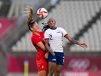 KASHIMA, JAPAN - AUGUST 2: Janine Beckie #16 of Canada goes up for a header with Crystal Dunn #2 of the USWNT during a game between Canada and USWNT at Kashima Soccer Stadium on August 2, 2021 in Kashima, Japan.