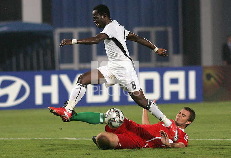Ghana's Emanuel Agyemang-Badu (8) leaps over Hungary's Andras Debreceni (5) during the FIFA Under 20 World Cup Semi-final match at the Cairo International Stadium in Cairo, Egypt, on October 13, 2009. Costa Rica won the match 1-2 in overtime play. Ghana won the match 3-2.