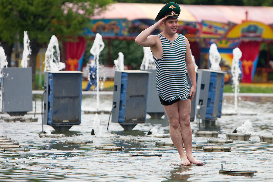 Moscow, Russia, 28/05/2010..A member of the Russian Border Troops salutes as he falls in a lake in Gorky Park as the regiment celebrated their annual holiday..