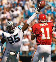 Carolina Panthers defensive end Charles Johnson (95) knocks down a pass from Kansas City Chiefs quarterback Damon Huard (11) during a NFL football game at Bank of America Stadium in Charlotte, NC.