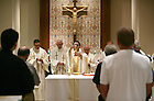Holy Cross priests celebrate Mass in the Corby Hall chapel