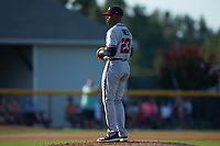 Danville Braves starting pitcher Darius Vines (23) looks to his catcher for the sign against the Burlington Royals at Burlington Athletic Stadium on July 13, 2019 in Burlington, North Carolina. The Royals defeated the Braves 5-2. (Brian Westerholt/Four Seam Images)