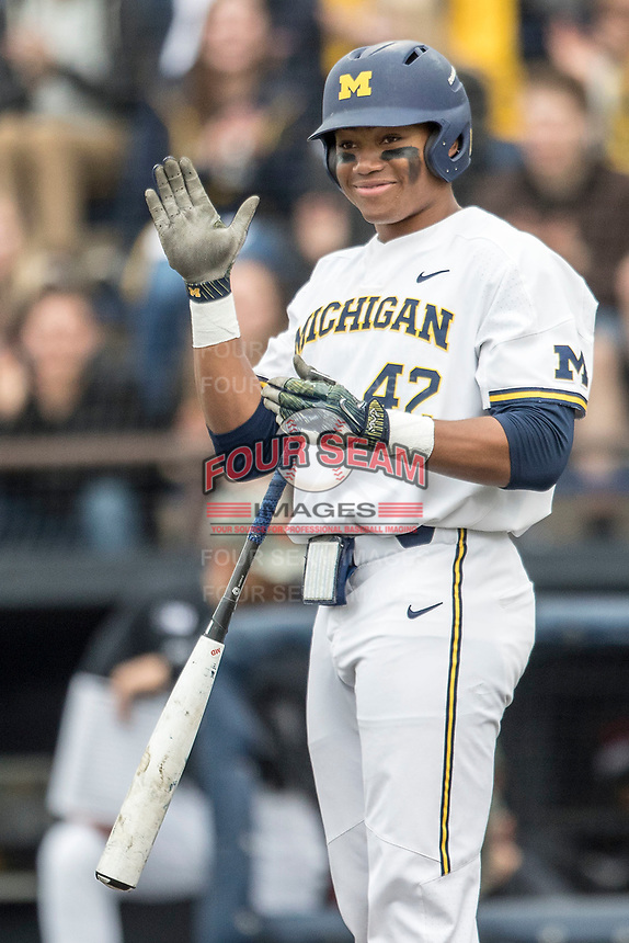 Michigan Wolverines outfielder Jordan Nwogu (42) claps at the plate against the Maryland Terrapins on April 13, 2018 in a Big Ten NCAA baseball game at Ray Fisher Stadium in Ann Arbor, Michigan. Michigan defeated Maryland 10-4. (Andrew Woolley/Four Seam Images)