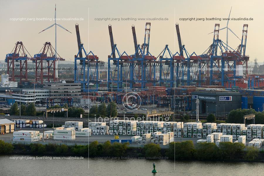 GERMANY Hamburg, Container terminal HHLA and Nordex wind turbine at Dradenau water treatment plant of Hamburg Wasser  in harbour / DEUTSCHLAND Hamburg, HHLA Containerterminal und Nordex Windkraftanlage auf dem Gelaende Klaerwerk Dradenau von Hamburg Wasser im Hamburger Hafen