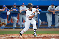 Stuart Fairchild (4) of the Wake Forest Demon Deacons squares to bunt against the Florida Gators in the completion of Game Two of the Gainesville Super Regional of the 2017 College World Series at Alfred McKethan Stadium at Perry Field on June 12, 2017 in Gainesville, Florida. The Demon Deacons walked off the Gators 8-6 in 11 innings. (Brian Westerholt/Four Seam Images)