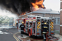 Firefighters attend a large factory fire the fire has already got a hold and can be seen blazing through the roof Oxfordshire UK. This image may only be used to portray the subject in a positive manner..©shoutpictures.com..john@shoutpictures.com