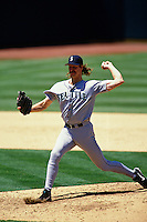 OAKLAND, CA - Randy Johnson of the Seattle Mariners pitches during a game against the Oakland Athletics at the Oakland Coliseum in Oakland, California in 1995. Photo by Brad Mangin