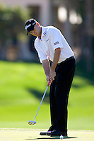 Bill Haas sinks his putt on the 18th green to win The Bob Hope Classic at PGA West Palmer Private.