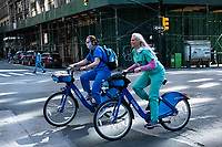 New York, New York City, during the time of the Coronavirus. Healthcare workers ride city bikes to work. It's wonderful to finally see  a smile on their faces.