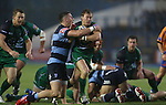 Blues wing Alex Cuthbert holds back Connacht scrum half Kieron Marmion.<br /> RaboDirect Pro 12<br /> Cardiff Blues v Connacht<br /> Cardiff Arms Park<br /> 13.09.13<br /> <br /> ©Steve Pope-SPORTINGWALES