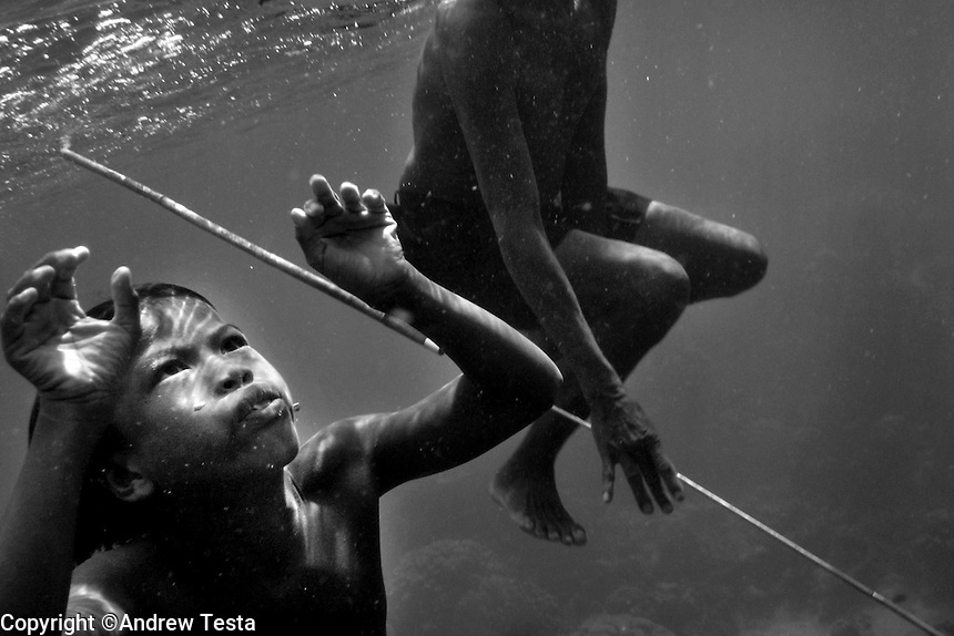 "THE MOKEN. 01..The Moken are a nomadic tribe who live on the Surin Islands islands 60 km off the coast of Thailand. Recent scientific studies have shown that the underwater eyesight of Moken children is more than50% percent better than the underwater eyesight of other children. Scientists believe that the Moken train their eyes to see better out of necessity, they have to hunt for fish, and also make out things on the sea bed far below them. Experiments are now underway in Sweden to see if other children can train their eyes in a similar way. The Moken spend a large part of their time in the sea, and seem almost as at home in that environment as on land. At present they have no Family names or citizensip, but the Thai authorities have proposed that they all be given the same second name, roughly translated it means ""Hero of the Sea"". The entire Moken population of the Surin Islands survived the recent Tsunami. News reports say that by the time the waves crashed ashore, the Moken were already on the higher ground and therefore safe. According to interviews they relied on the sayings of their ancestors which have been passed down through generations (they have no written language) which warn of the sea disappearing and then returning with a terrible force."