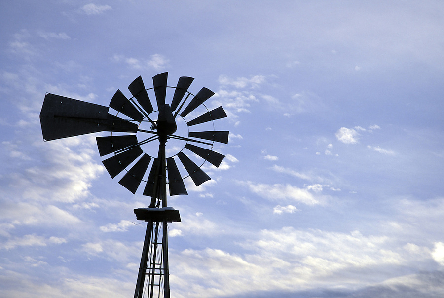 Windmill silhouetted against sky with clouds, Wenas Valley, near Yakima, Washington