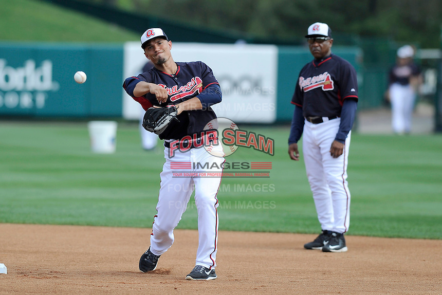 Second baseman Jace Peterson (28) of the Atlanta Braves works out as coach Terry Pendleton looks on before a Spring Training game against the New York Yankees on Wednesday, March 18, 2015, at Champion Stadium at the ESPN Wide World of Sports Complex in Lake Buena Vista, Florida. The Yankees won, 12-5. (Tom Priddy/Four Seam Images)