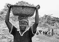 Stone crushers woman surrounding Garaku, Nassarawa State, Nigeria.