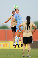 Becky Edwards (14) of FC Gold Pride and Yael Averbuch (13) of Sky Blue FC go up for a header. FC Gold Pride defeated Sky Blue FC 1-0 during a Women's Professional Soccer (WPS) match at Yurcak Field in Piscataway, NJ, on May 1, 2010.
