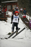 Six year old Oskar Opshal closes his eyes as he jumos during a ski jump comptetition in Lommedalen, outside Oslo.
