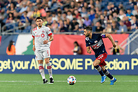 FOXBOROUGH, MA - JULY 7: Carles Gil #22 of New England Revolution dribbles during a game between Toronto FC and New England Revolution at Gillette Stadium on July 7, 2021 in Foxborough, Massachusetts.