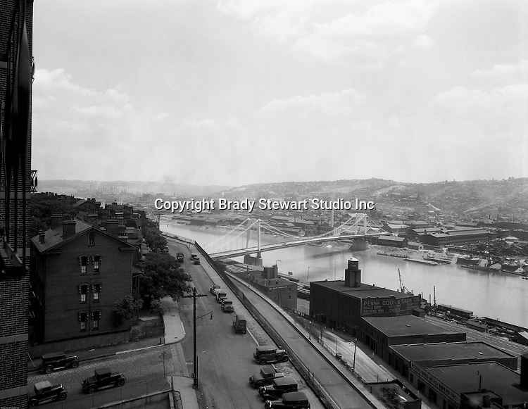 Pittsburgh PA:  View looking south towards the South Side and Monongahela River from the bluff at Duquesne University.  The view includes the construction of the 10th Bridge which opened to traffic in 1933.