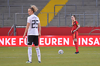 Tessa Wullaert (9) of Belgium and German Lena Lattwein (26) pictured during a friendly female soccer game between the national teams of Germany and  Belgium , called the Red Flames  in a pre - bid tournament called Three Nations One Goal with the national teams from Belgium , The Netherlands and Germany towards a bid for the hosting of the 2027 FIFA Women's World Cup , on Sunday 21 st of February 2021  in Aachen , Germany . PHOTO SPORTPIX.BE   SPP   STIJN AUDOOREN