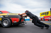 Aug 30, 2019; Clermont, IN, USA; Crew members push the car of NHRA factory stock driver Leah Pritchett during qualifying for the US Nationals at Lucas Oil Raceway. Mandatory Credit: Mark J. Rebilas-USA TODAY Sports