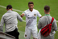 LOS ANGELES, CA - OCTOBER 25: Jonathan dos Santos #8 of the Los Angeles Galaxy leaps high for a ball during a game between Los Angeles Galaxy and Los Angeles FC at Banc of California Stadium on October 25, 2020 in Los Angeles, California.