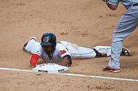 Rochester Red Wings first baseman Reynaldo Rodriguez (23) slides head fist into third on a triple during a game against the Pawtucket Red Sox on July 1, 2015 at Frontier Field in Rochester, New York.  Rochester defeated Pawtucket 8-4.  (Mike Janes/Four Seam Images)