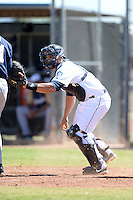 Seattle Mariners catcher Yojhan Quevedo (60) during an Instructional League game against the Milwaukee Brewers on October 4, 2014 at Peoria Stadium Training Complex in Peoria, Arizona.  (Mike Janes/Four Seam Images)