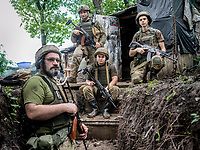 Vladimir (left), with other Ukrainian government soldiers, at their position near the town of Krasnotiorivke. The enemy, Russian-backed separatists, are in their positions only a few hundred metres away. The frontline here is very active with snipers and shelling from mortars.