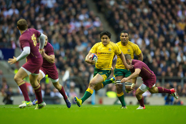 Ben Tapuai of Australia accelerates in midfield during the Cook Cup between England and Australia, part of the QBE International series, at Twickenham on Saturday 17th November 2012 (Photo by Rob Munro)