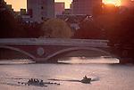 Rowing, Cambridge, Coach coaching eight oared racing shell, Charles River, Weeks Bridge, Harvard University at dawn, Cambridge, Massachusetts, New England, USA,.