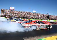 Sept. 21, 2013; Ennis, TX, USA: NHRA pro stock driver V. Gaines (near lane) burns out alongside Rodger Brogdon during the Fall Nationals at the Texas Motorplex. Mandatory Credit: Mark J. Rebilas-