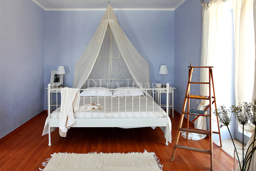 white bed with curtain