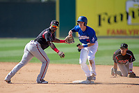 Lake Elsinore Storm Ruddy Giron (2) and Rancho Cucamonga Quakes Connor Wong (33) in action at LoanMart Field on May 28, 2018 in Rancho Cucamonga, California. The Storm defeated the Quakes 8-5.  (Donn Parris/Four Seam Images)