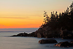 Post-sunset glow touches the granite cliffs along the Eben's Head Trail in Acadia National Park on Isle au Haut, Maine