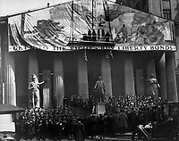 Henry Reuterdahl (Lieut. U.S.N.R.) and N.C. Wyeth, noted artist, putting the last touches on the giant battle picture before the Sub-Treasury building, New York City, in the Third Liberty Loan campaign.  April 1918.    Paul Thompson. (War Dept.)<br /> Exact Date Shot Unknown<br /> NARA FILE #:  165-WW-61-62<br /> WAR & CONFLICT BOOK #:  520