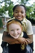 Children in the playground at St Peter's Primary School, Harbourne, Birmingham.