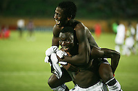 Ghana's Daniel Opare (14) jumps on the back of Dominic Adiyiah (20) while celebrating the 3-2 wing over South Korea during the FIFA Under 20 World Cup Quarter-final match at the Mubarak Stadium  in Suez, Egypt, on October 09, 2009.