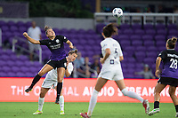 ORLANDO, FL - SEPTEMBER 11: Ali Riley #7 of the Orlando Pride heads the ball during a game between Racing Louisville FC and Orlando Pride at Exploria Stadium on September 11, 2021 in Orlando, Florida.