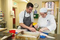 Mark Anderson of the Ruddington Arms bones cod with Claire Chocholko